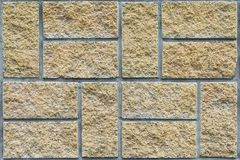 Beige stone tile on the building facade background, texture, se Royalty Free Stock Photo