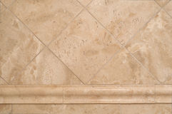Beige Stone Tiles on Bathroom Wall Stock Photography