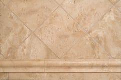 Beige Stone Tiles on Bathroom Wall Stock Photography