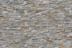 Beige stone wall background Royalty Free Stock Photos
