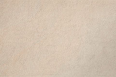 Beige stone wall. Background texture Royalty Free Stock Photography