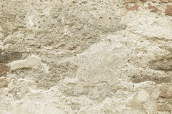 Beige stone wall background texture. Close up Stock Photos