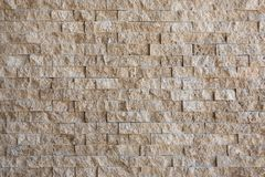 Beige Stone Wall Covering Royalty Free Stock Image