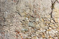 Beige stonewall texture. Clos up of beige stone wall texture background surface Royalty Free Stock Photo