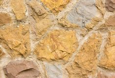 Beige stonewall texture. Clos up of beige stone wall texture background surface Royalty Free Stock Images
