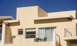 Beige Stucco Balcony Against Clear Blue Sky Royalty Free Stock Photos