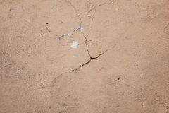 Beige stucco wall crackle surface. Light beige textured background. Grunge texture. Rough weathered backdrop. Design abstract frame retro house pattern vintage royalty free stock photos