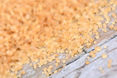 Beige sugar on table Royalty Free Stock Photos