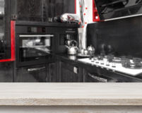 Beige table on defocused black kitchen background Stock Photo