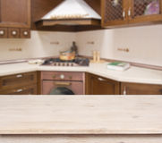 Beige table on defocused brown kitchen interior background royalty free stock image
