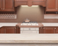 Beige table on defocused kitchen stove interior background Stock Photos