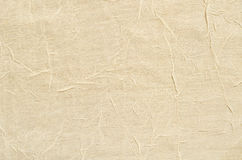 Textile background. Beige textile background with folds Stock Photo