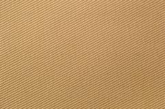 Beige textile background. Weaved textile background on beige base Royalty Free Stock Image