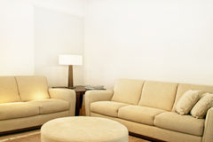 Beige textile sofas. Living room with two beige textile sofas Royalty Free Stock Photos