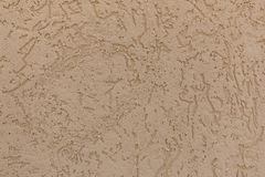 Beige texture in the form of a plane of stone eaten by worms.  royalty free stock photography