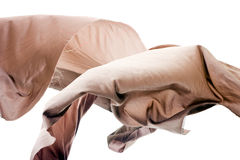 Beige Thai Silk in Mid-Air. Beautiful thai silk shot in mid-air in studio Royalty Free Stock Photography