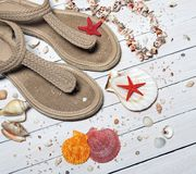 Beige Thong Flat Sandals Placed Beside Seashells Royalty Free Stock Image