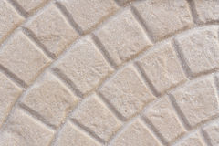 Beige tiled pavement texture background Stock Photography