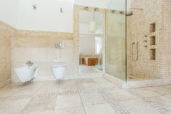 Beige tiles on the wall Royalty Free Stock Photography