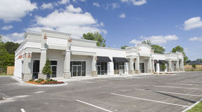 Beige toned commercial strip mall Stock Images