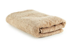 Beige towel isolated on a white Royalty Free Stock Image
