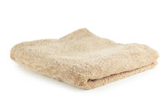 Beige towel isolated on a white Stock Photos