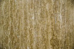 Beige travertine granite natural stone tile pattern in abstract brown color, close up. royalty free stock photography