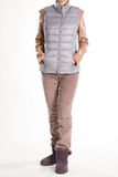 Beige trousers and bicolor outerwear. Stock Photography
