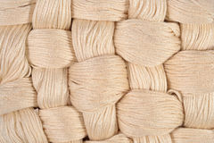 Beige twisted skeins of floss as background texture Stock Photography