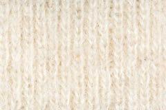 Beige und weißer Beschaffenheitshintergrund des woolen Gewebes, Abschluss oben Lizenzfreie Stockfotos