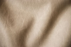 Beige undulating leather. For background usage Stock Photos