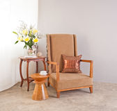 Beige upholstered chair Royalty Free Stock Photo
