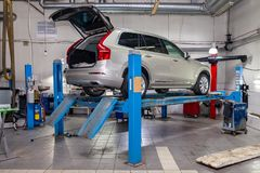 Beige used car stands on the stand wheel alignment convergence of the car in the workshop for repair of vehicles. Auto service royalty free stock images