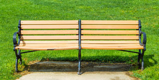 Beige varnished double bench outside Royalty Free Stock Photography