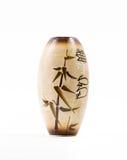 Beige vase med hieroglyphs som isoleras på vitbakgrund Arkivbilder
