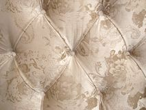 Beige velour upholstery with a button-down background for luxurious decoration. stock photography