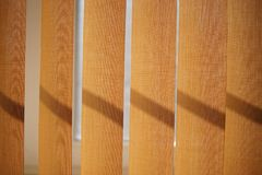 Beige vertical blinds closeup royalty free stock image