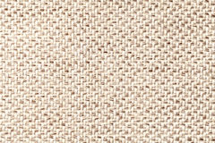 Beige vintage fabric with woven texture closeup. Textile macro background Stock Images