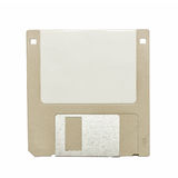 Beige vintage floppy disk on white. Top view of a beige vintage floppy disk on white background Stock Photos