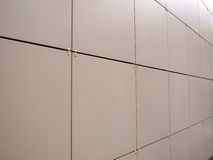 Beige wall of the large decorative tiles Royalty Free Stock Photos