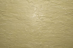 Beige wall with plaster relief Stock Photos