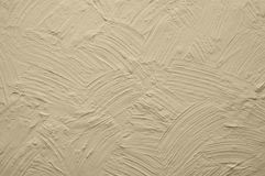 Beige wall with plaster relief. Abstract drawing Royalty Free Stock Photography