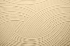 Beige wall with plaster relief. Abstract drawing Royalty Free Stock Photos