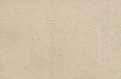 Beige wall stucco texture in a sunny day as background Royalty Free Stock Photo