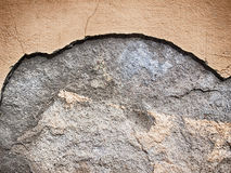 Beige wall texture with cracks and damage, light background Stock Photos