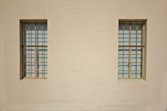 Beige wall two windows Royalty Free Stock Images