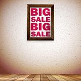Beige wall wooden floor with Big sale frame. Royalty Free Stock Photo