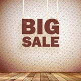 Beige wall wooden floor with Big sale frame. Stock Images