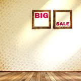 Beige wall wooden floor with Big sale frame. Stock Image