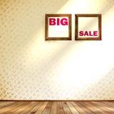 Beige wall wooden floor with Big sale frame. Stock Image